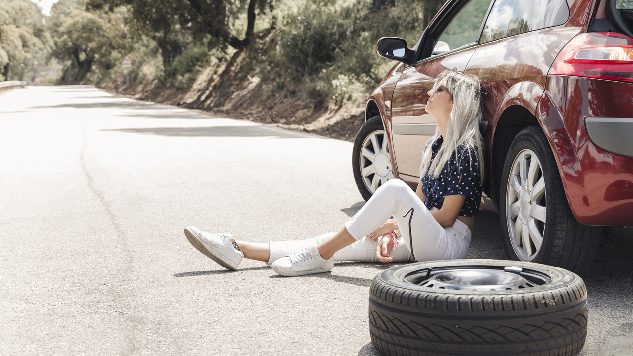 Woman Next To Car Waiting On Flat Tire Service Call