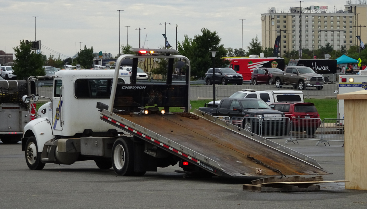 Flatbed Tow Truck With Bed Hydraulics Engaged