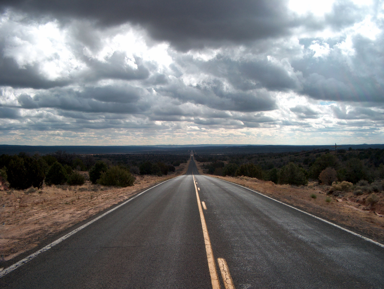Lonely Highway During Long Distance Towing Service Job
