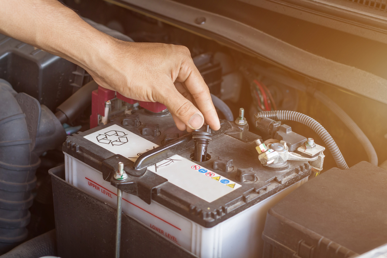 Tow-Tech-Performing-Car-Jump-Start-Service-On-Battery