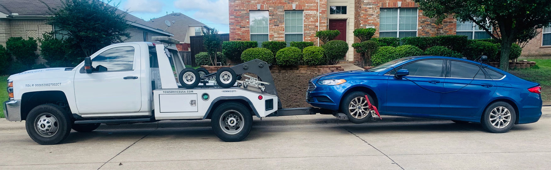 Wheel Lift Tow Truck In NC Hauling Blue Car